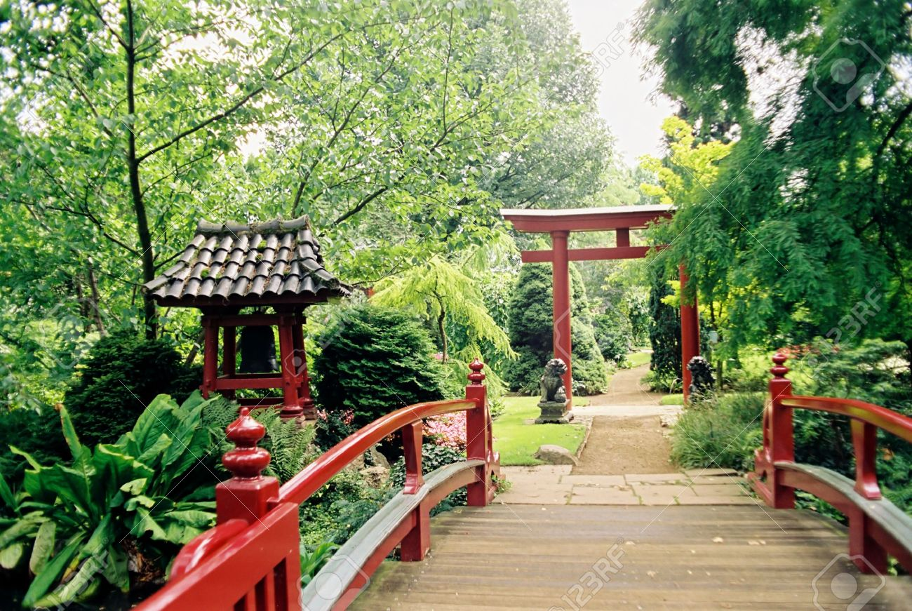 red bridge enterance to small japanese garden stock photo 3943459