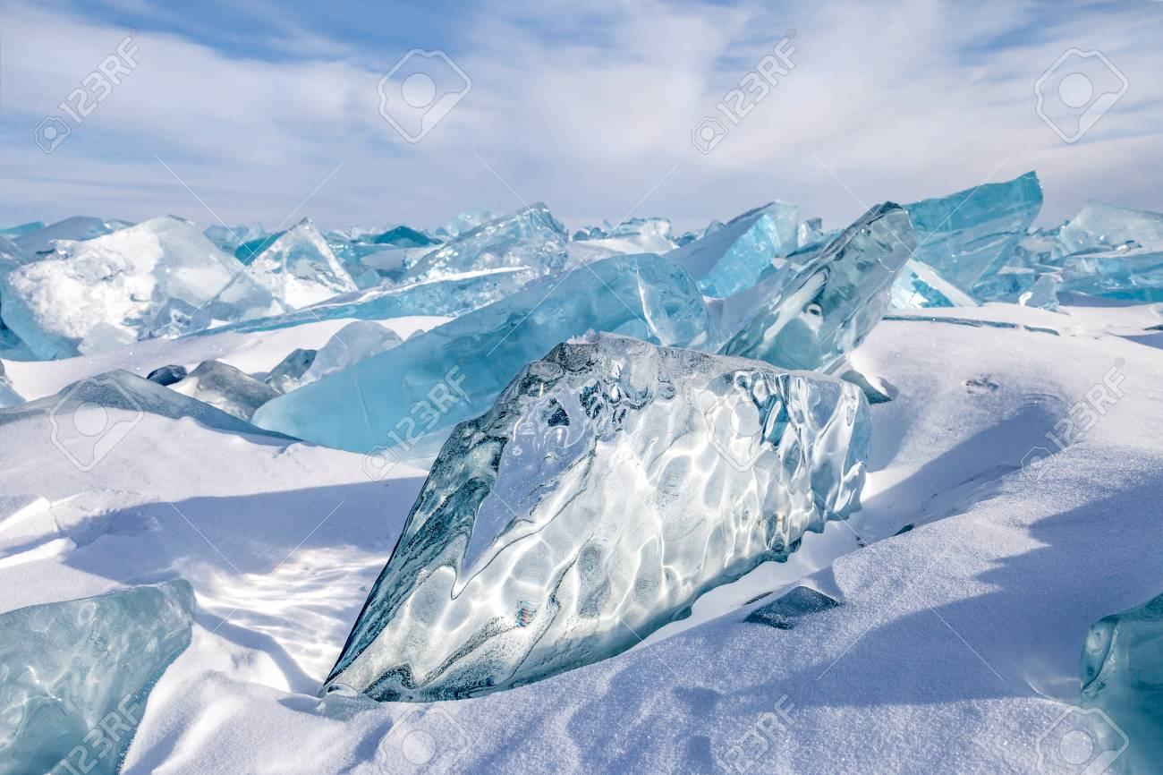 Beautiful blocks of blue natural ice on sky background Stock Photo - 70946352