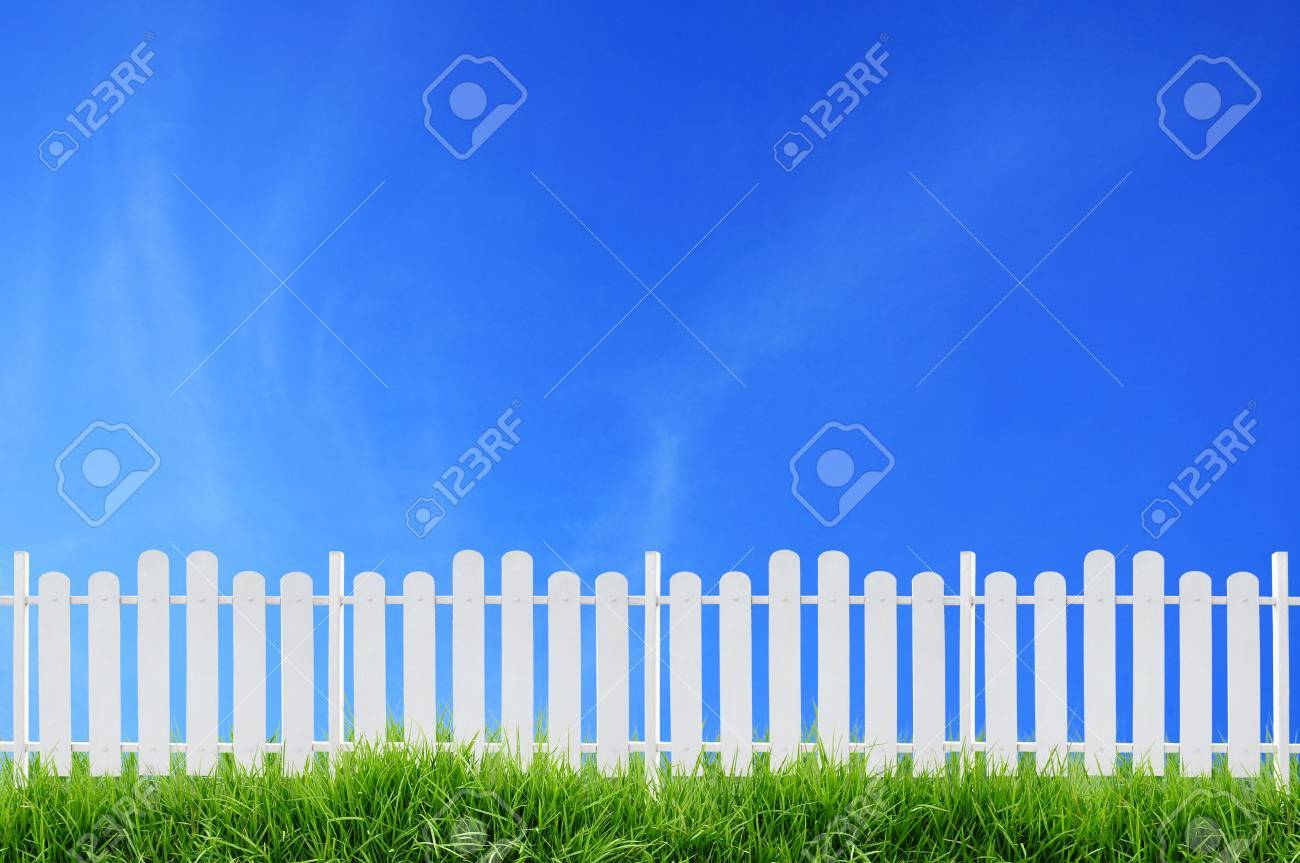 white fence and blue sky - 14590587