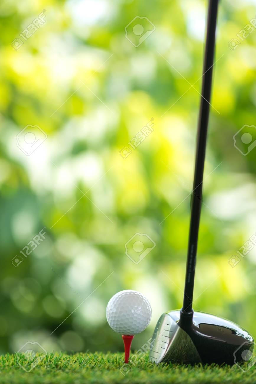 drive a golf ball on tee - 62298106