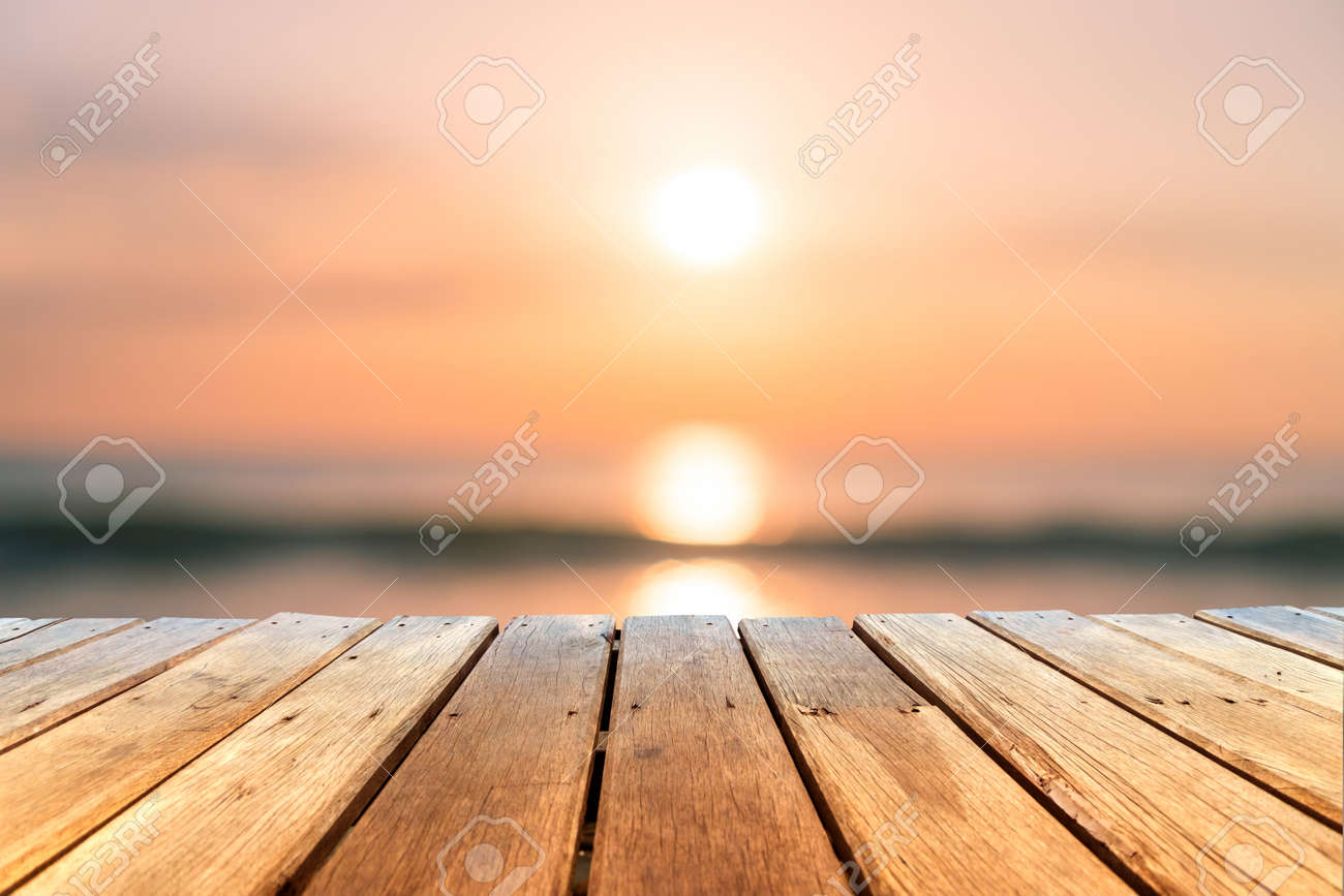 Selective focus of old wood table with blur beautiful beach background for display your product. - 130097454