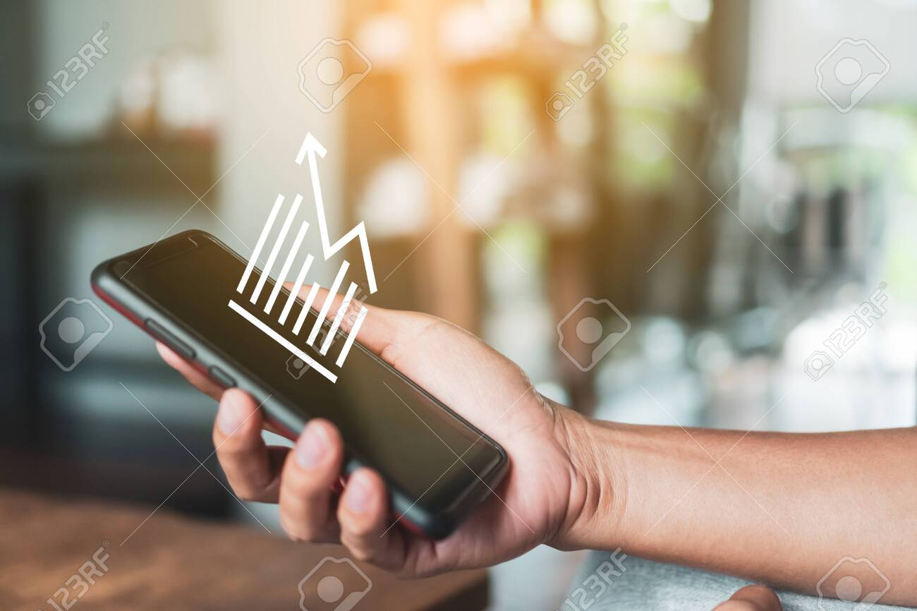 Market stock graph icon screen of smartphone background. Financial business technology freedom dream life using internet freedom life concept. - 145424314