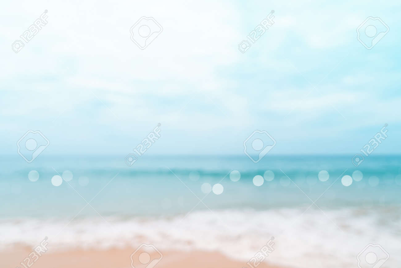 Blur tropical nature clean beach and white sand in summer with sun light blue sky and bokeh abstract background. - 154744289