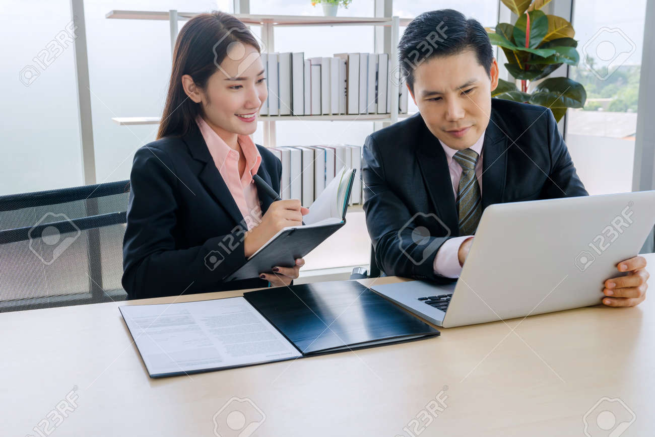 Concept corporate couple business people, handsome businessman Confident and employees Beautiful office woman Are present talking about a new financial company's project. professional teamwork. - 153039539