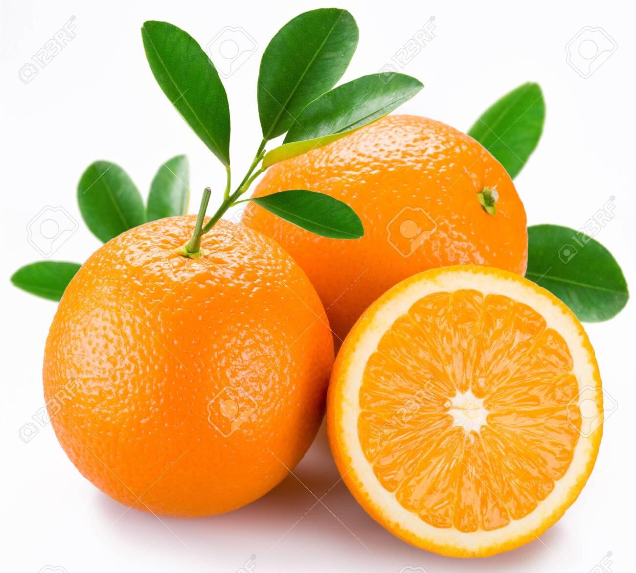 Oranges fruit citrus half sprig leaves white background . - 130679622