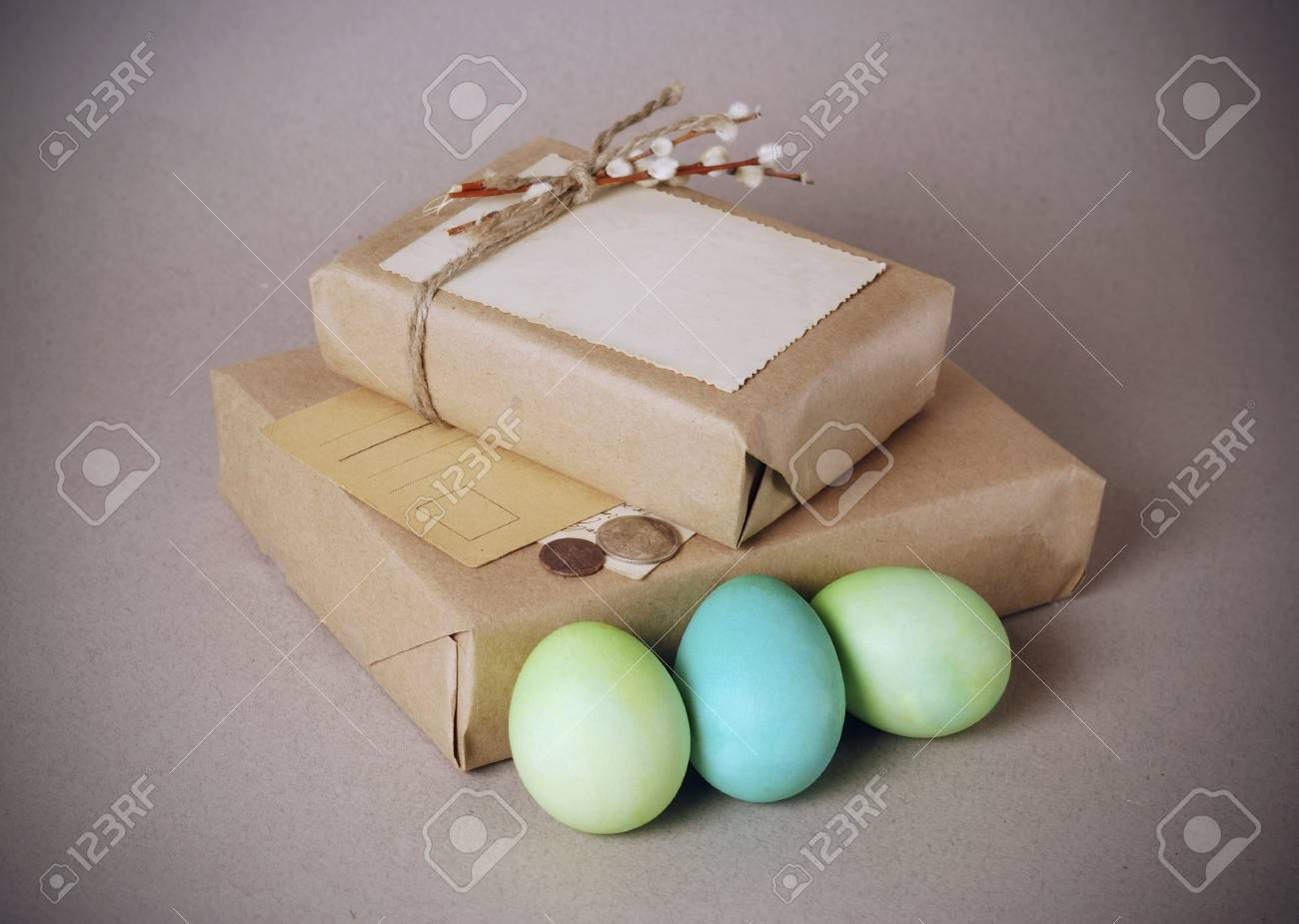 Vintage still life with easter eggs and gift boxes in craft paper stock photo vintage still life with easter eggs and gift boxes in craft paper negle Image collections