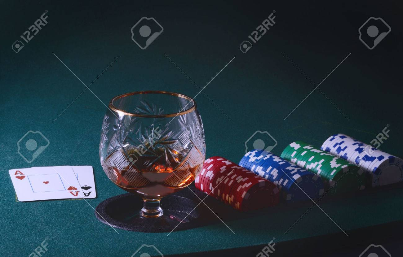 Awe Inspiring Poker Table With Glass Of Cognac Or Whiskey Casino Chips And Home Remodeling Inspirations Basidirectenergyitoicom