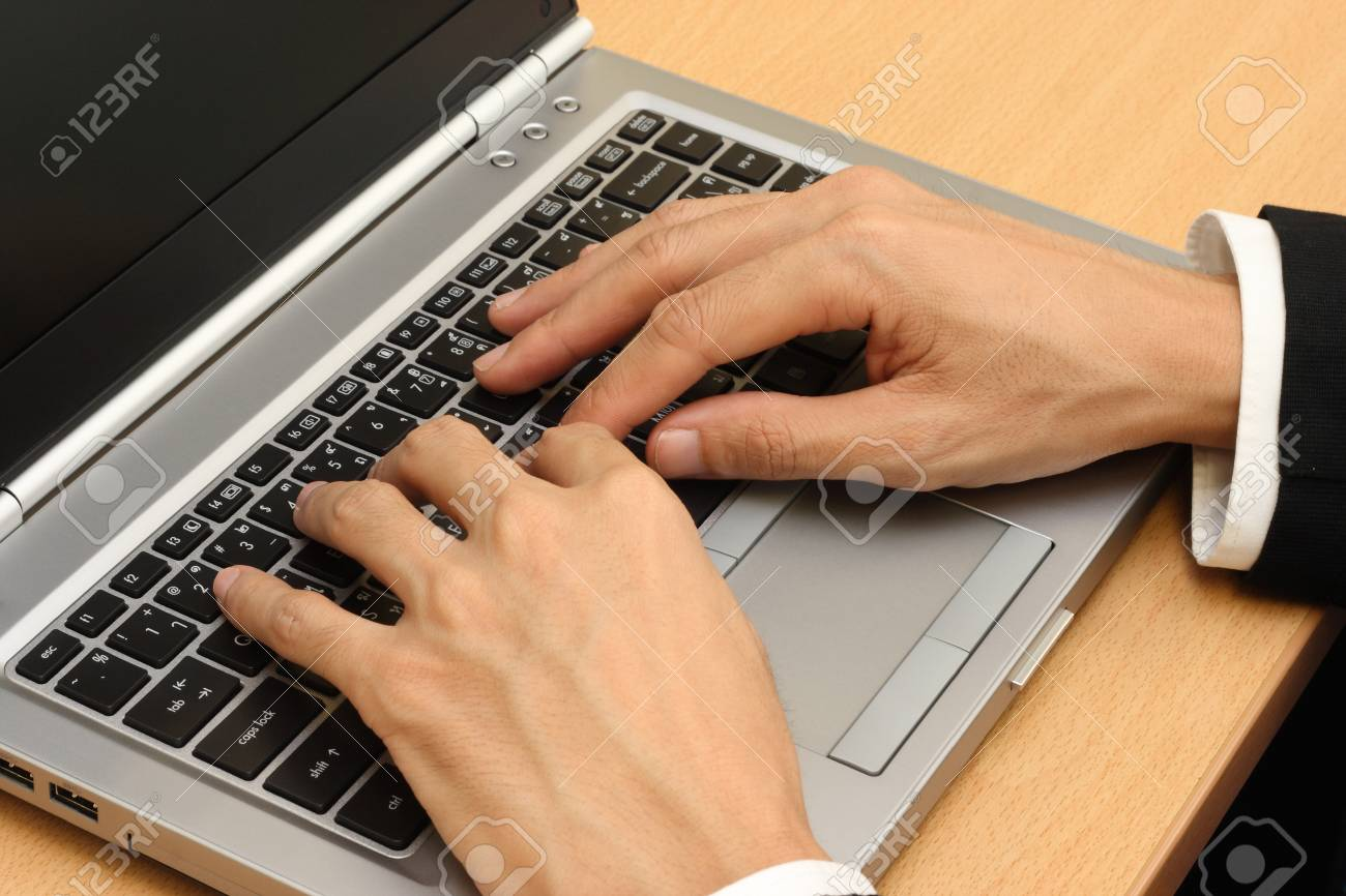 businessmans hands  typing laptop Stock Photo - 10433396