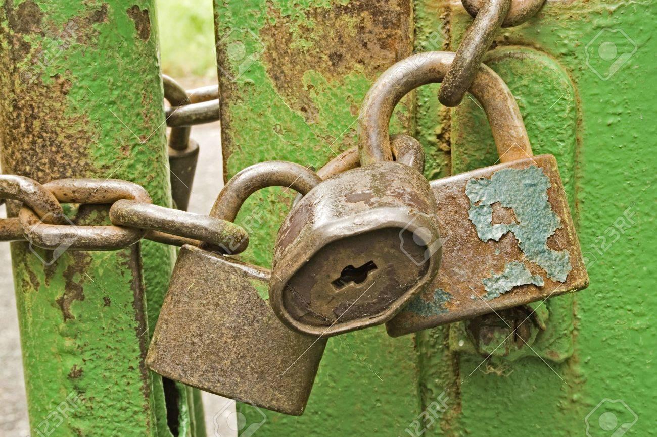 three padlocks with a chain - 3623867