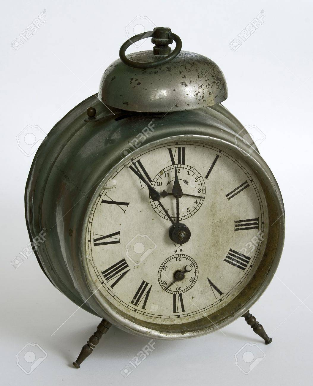 a vintage alarm clock isolated in white stock photo