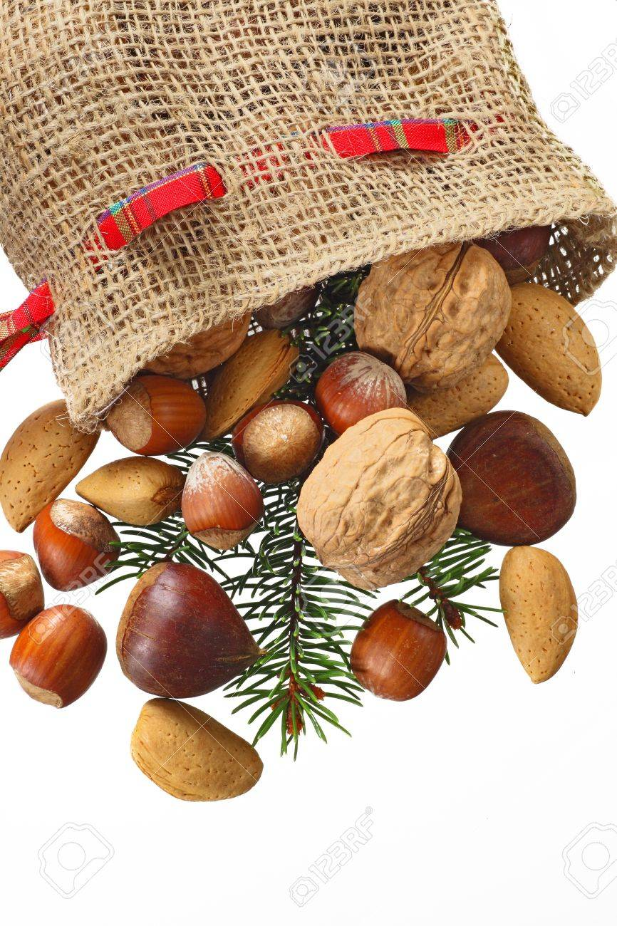 Christmas Stocking with nuts isolated in white - 8379710