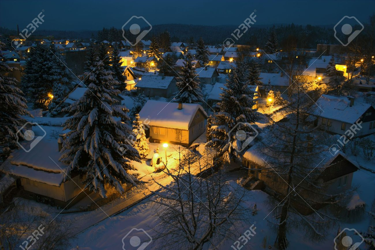 View to a night village town covered with snow - 8891503