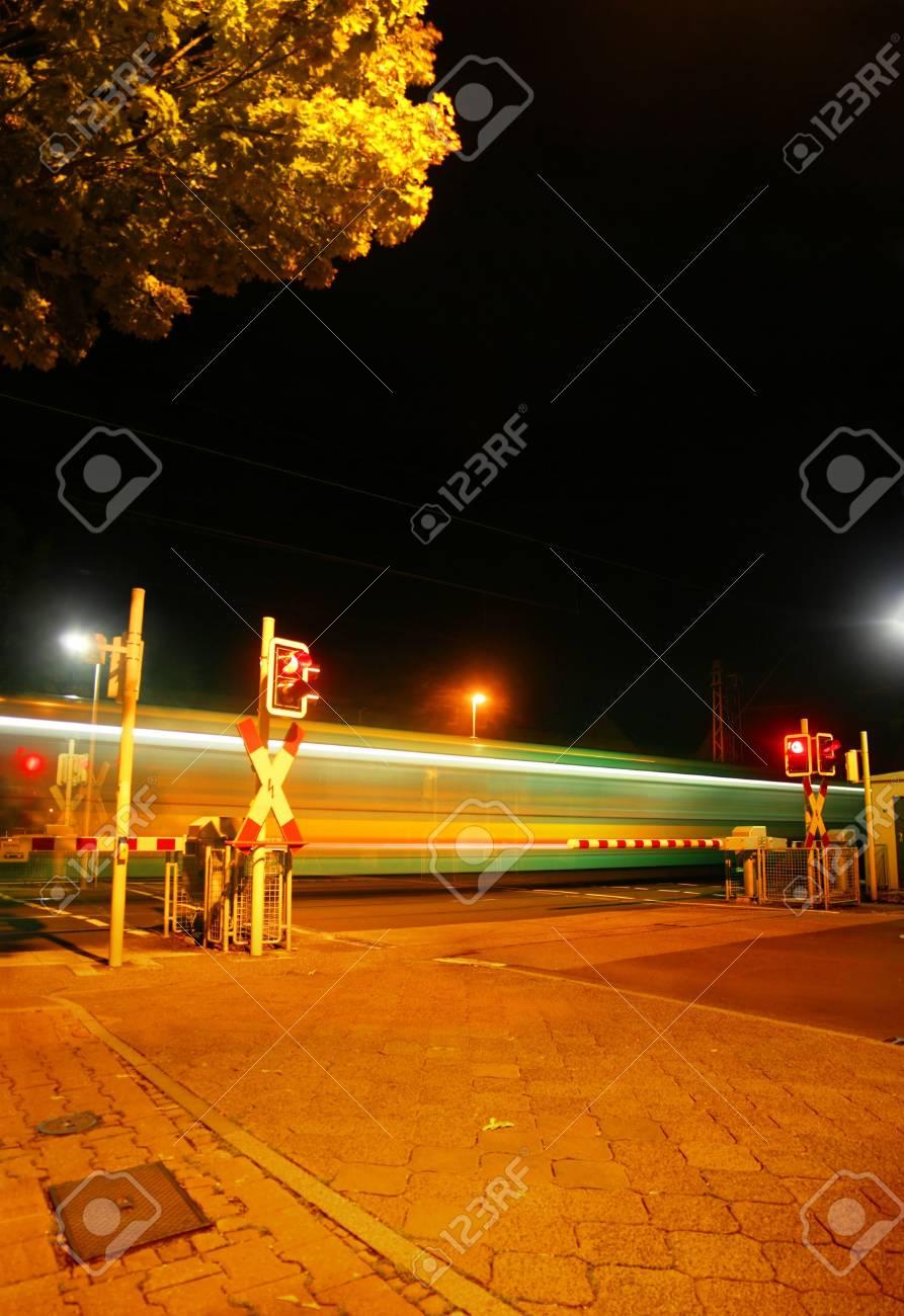 Railroad crossing at night of a Metro (U-Bahn) in Bad Homburg
