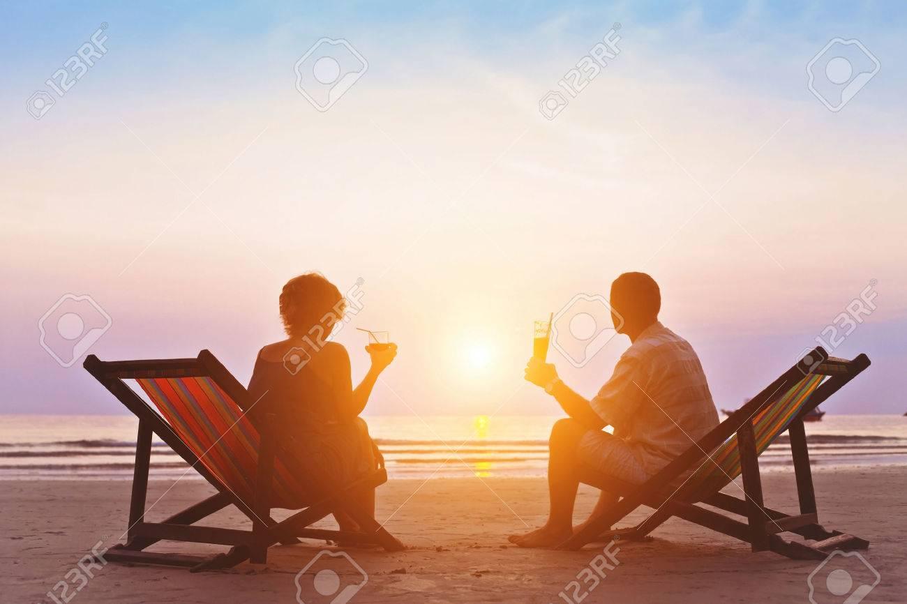 family enjoying romantic sunset on the beach - 53069811