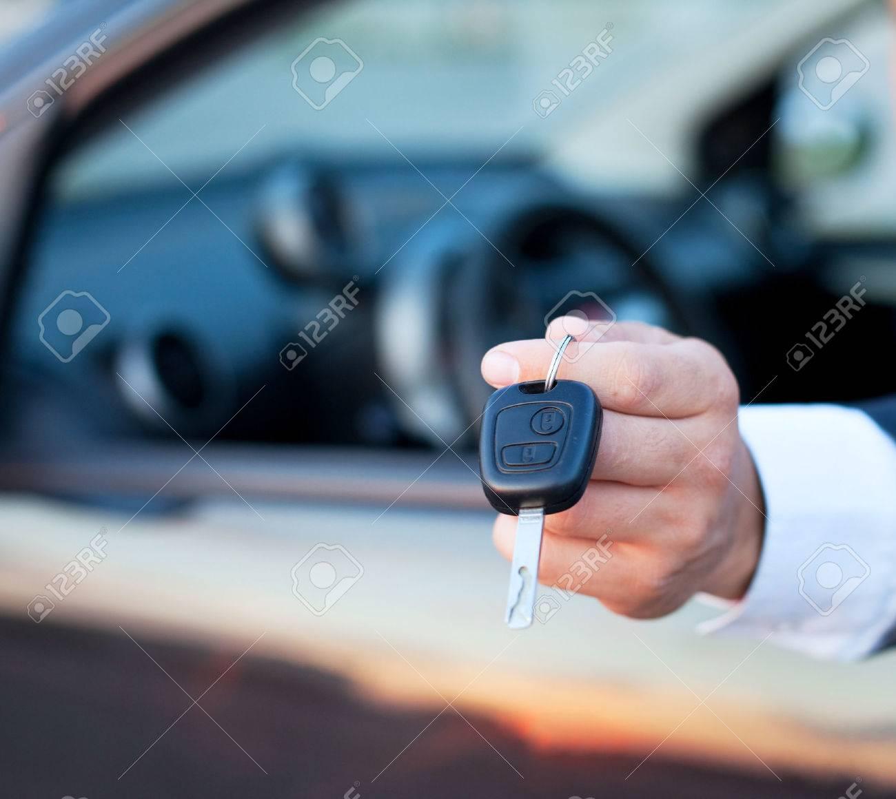 car keys in the hand, rent or buy car - 53076691