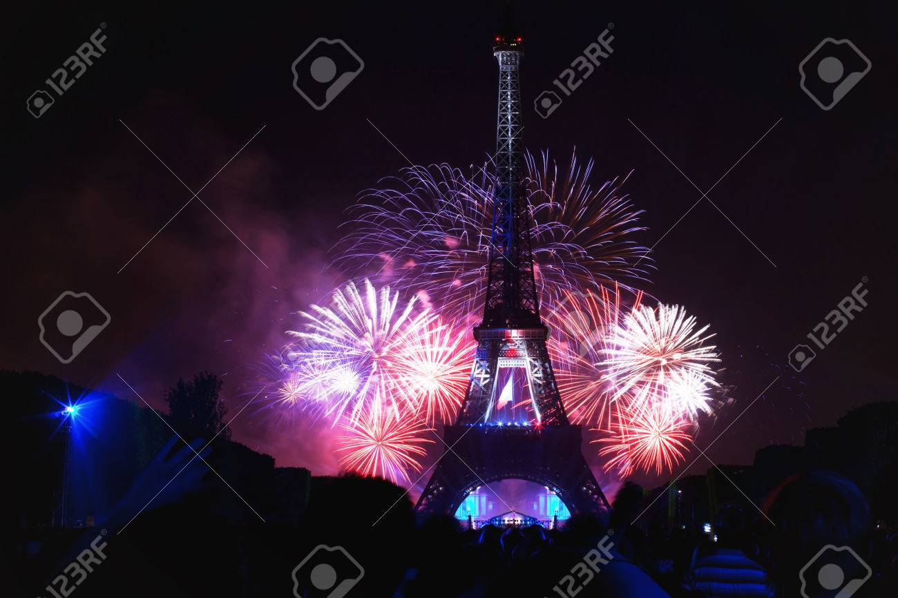 paris - july 14: night scene of fireworks at eiffel tower in.. stock