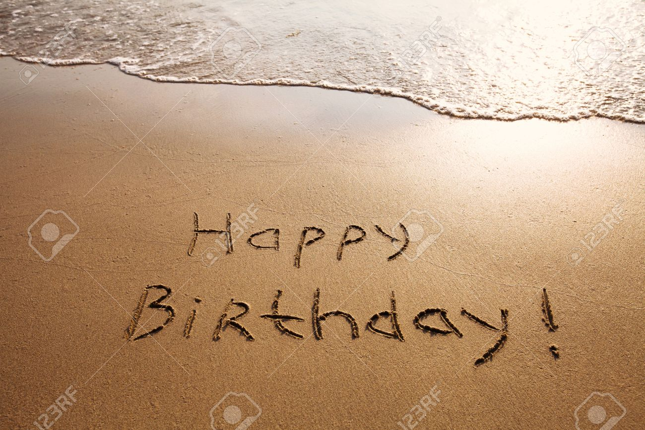 Happy Birthday Postcard On The Beach Stock Photo