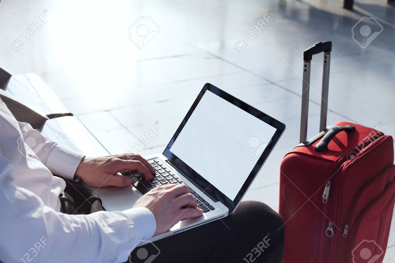 online banking on internet in business travel, laptop with empty screen - 53112543
