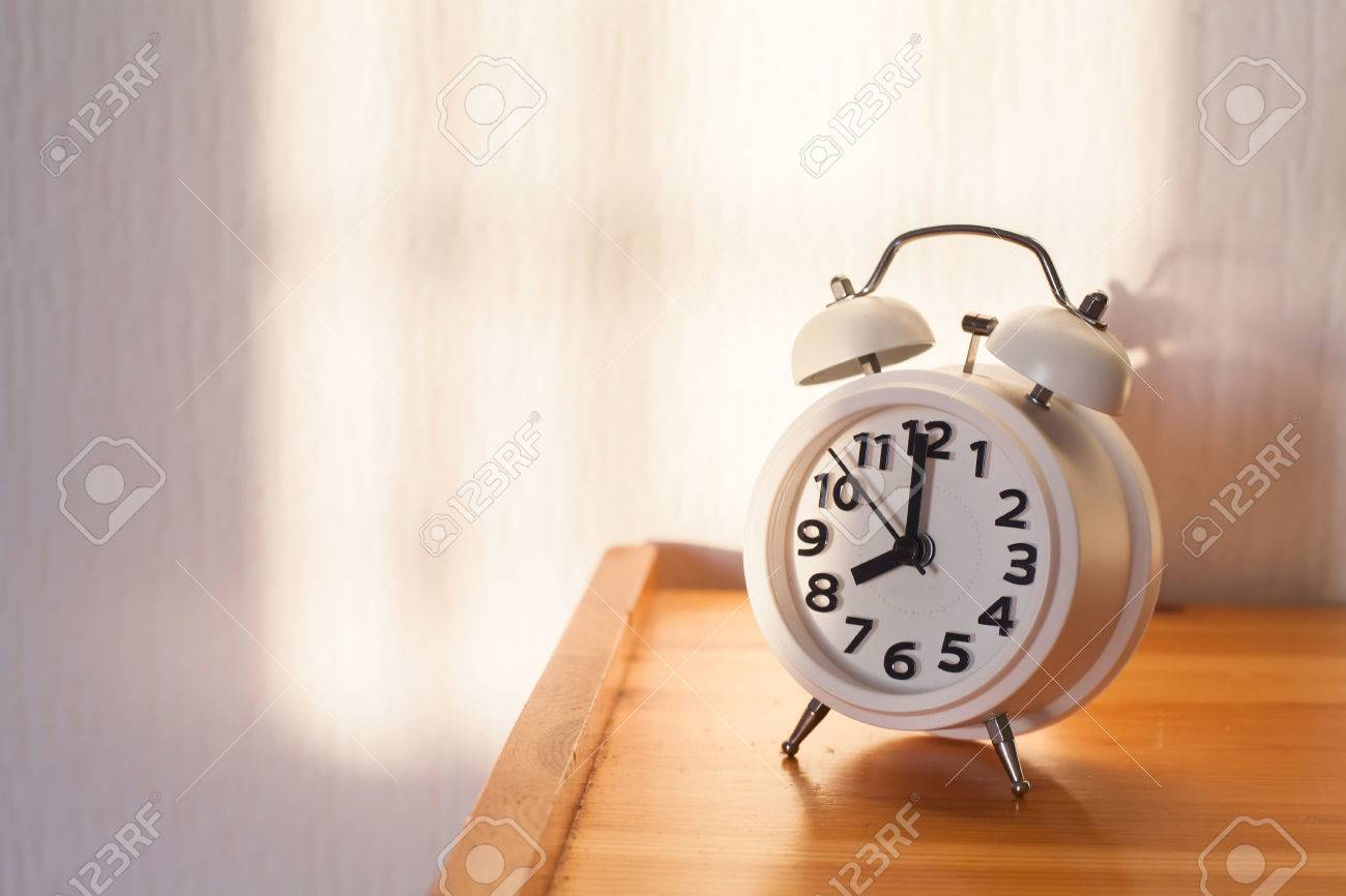 Amazing Eight Ou0027clock In The Morning, Alarm Clock On Bedside Table Stock Photo