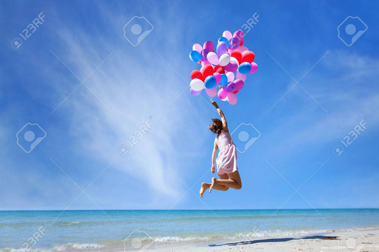 dream concept, girl flying on multicolored balloons in blue sky, imagination and creativity - 77502107