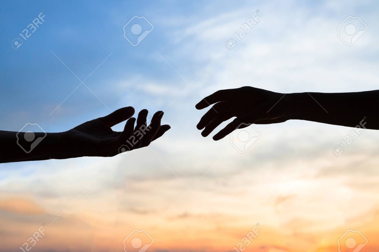mercy, two hands silhouette on sky background, connection or help concept - 77348807