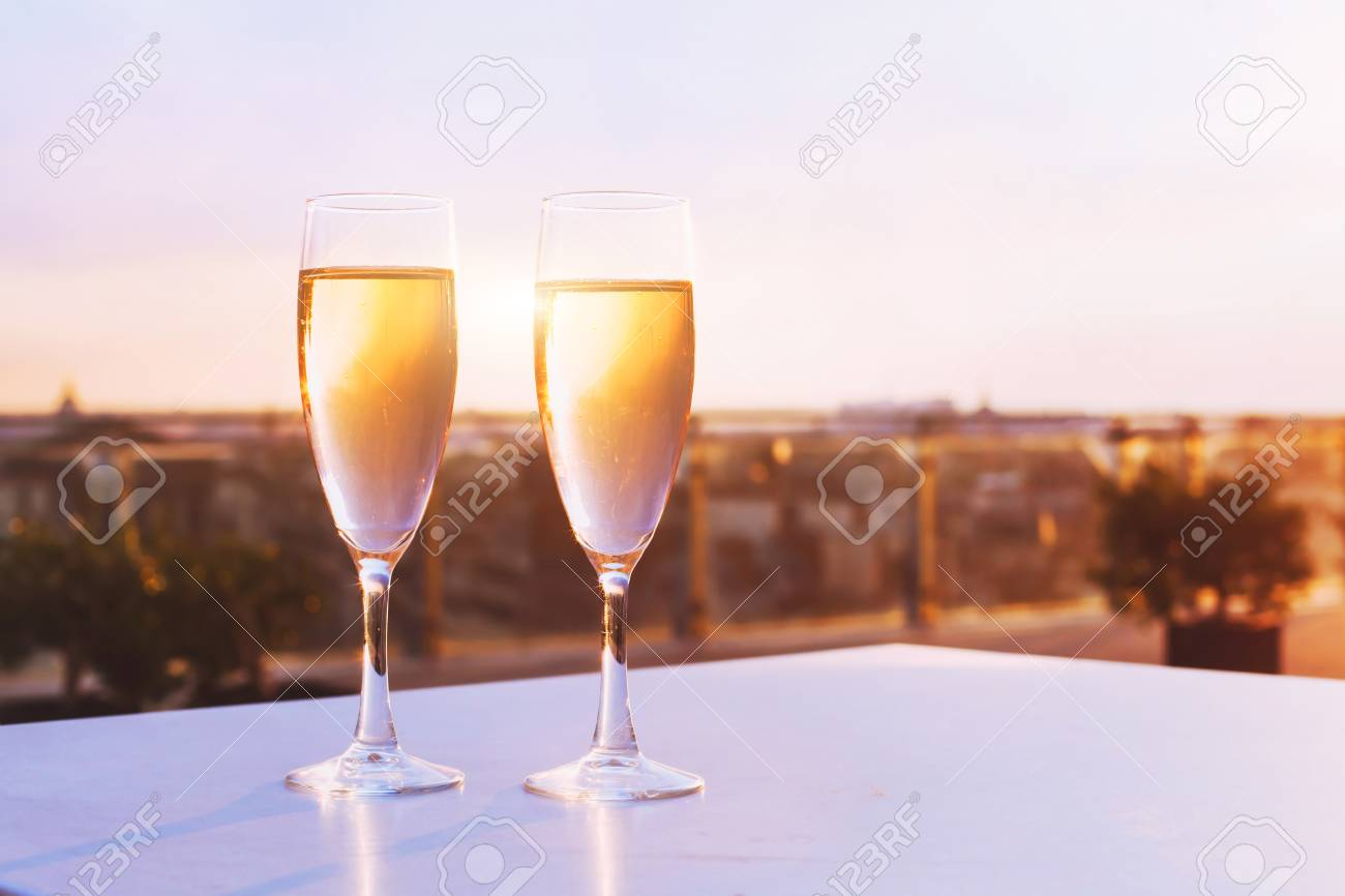 Two Glasses Of Champagne At Rooftop Restaurant With View Of City Stock Photo Picture And Royalty Free Image Image 82435089