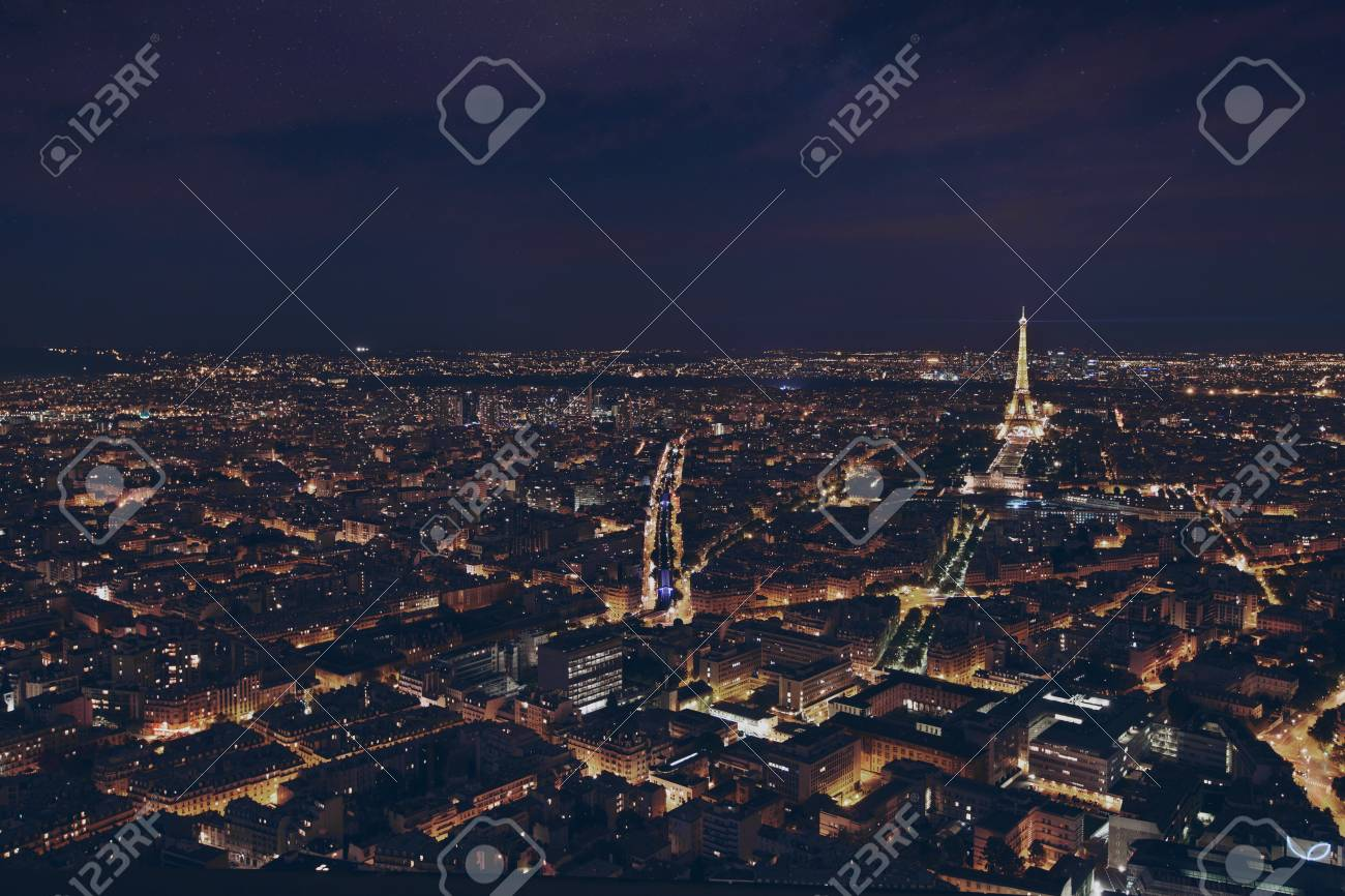 PARIS, FRANCE - AUGUST 29 2015: beautiful night panoramic aerial view of Paris and illuminated Eiffel Tower, city lights - 111083338