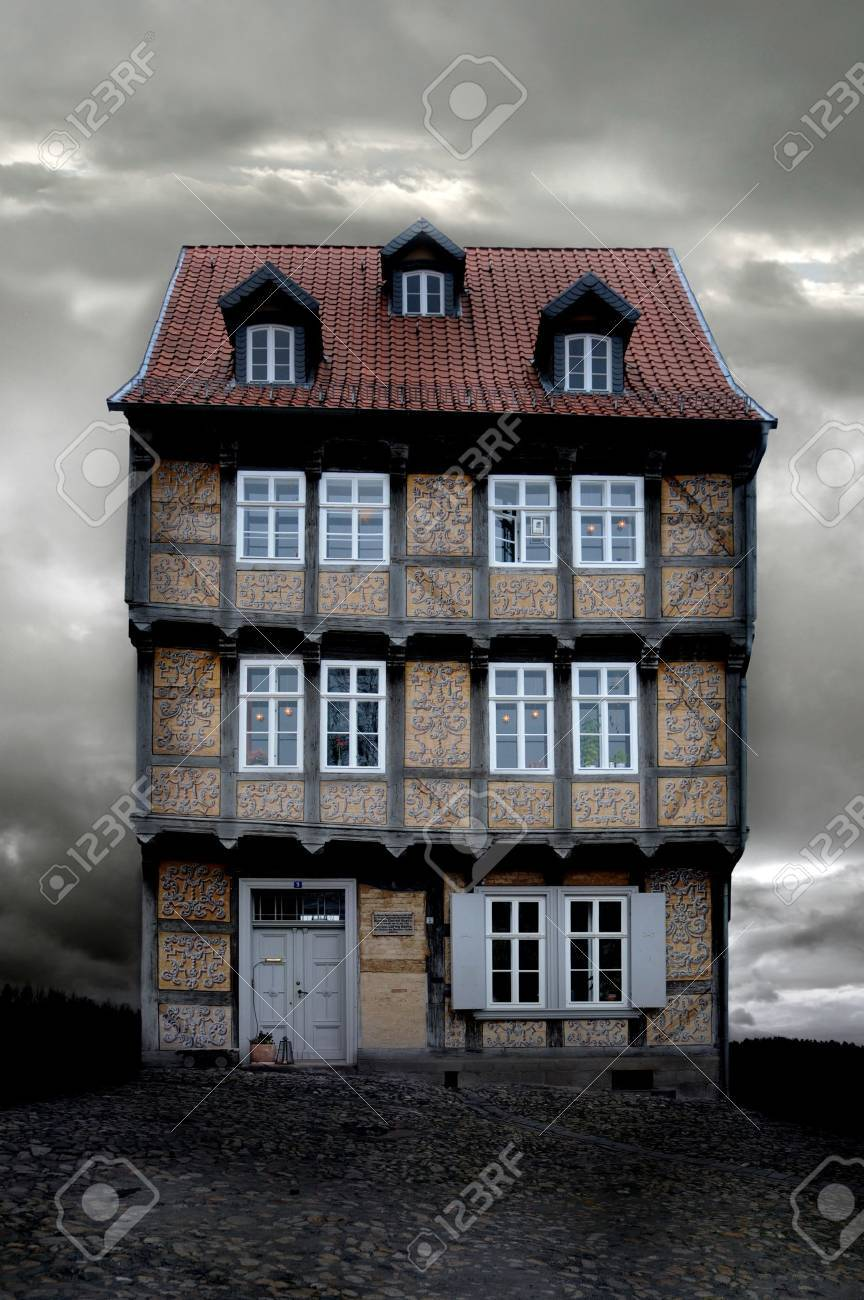 historical German house with X-mas lights on a gloomy evening Stock Photo - 8763052