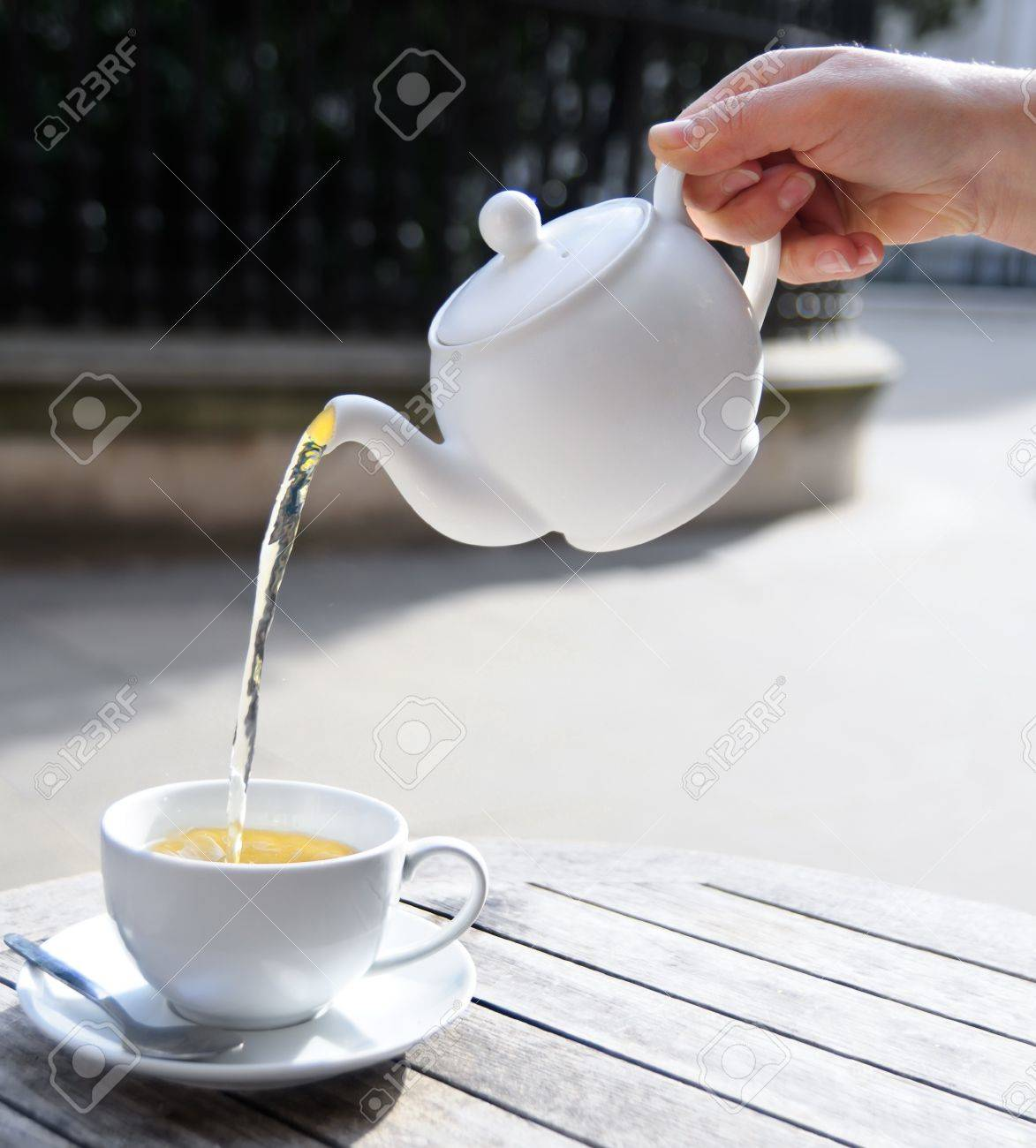 Hand Poures Green Tea From White Ceramic Teapot Into A Matching Tea Cup Stock Photo Picture And Royalty Free Image Image 14387190 Hd wallpaper tea cup kettle hands