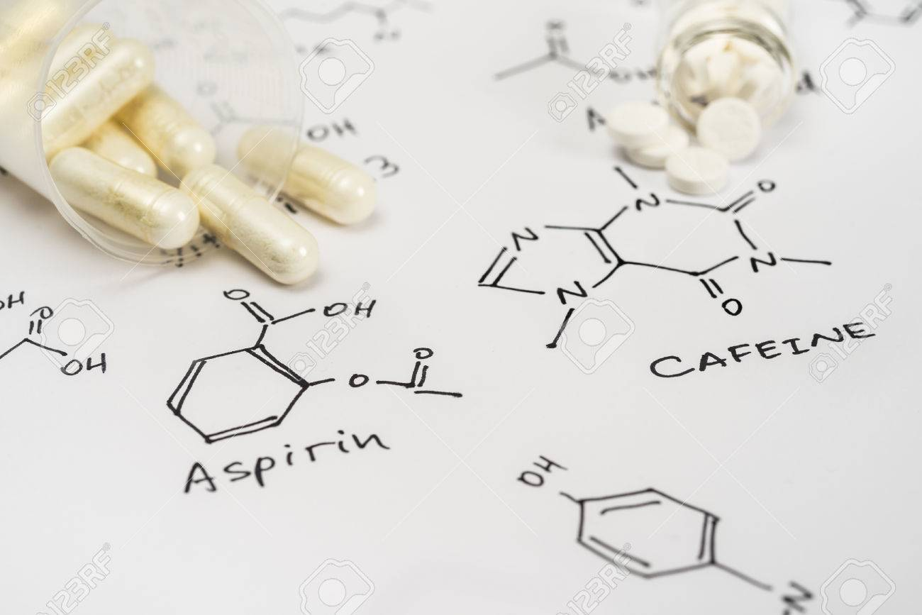 Aspirin in capsules and caffein in tablets on paper with their chemical formula - 29300956