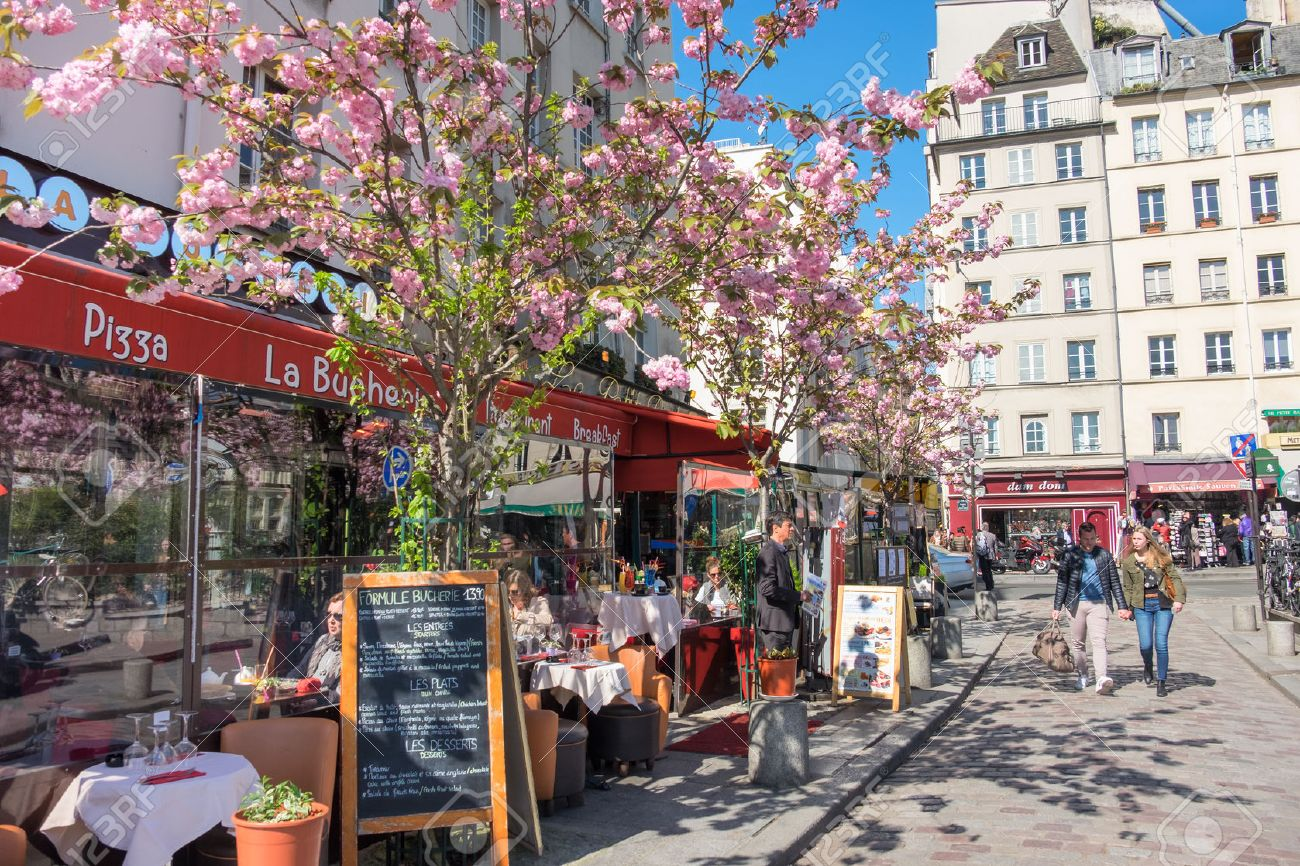PARIS, FRANCE - APRIL 18 2016: A row of restaurants in Latin Quarter at Spring. Once a student neighbourhood, now the district is one of the most popular among tourists and locals alike. - 56237244