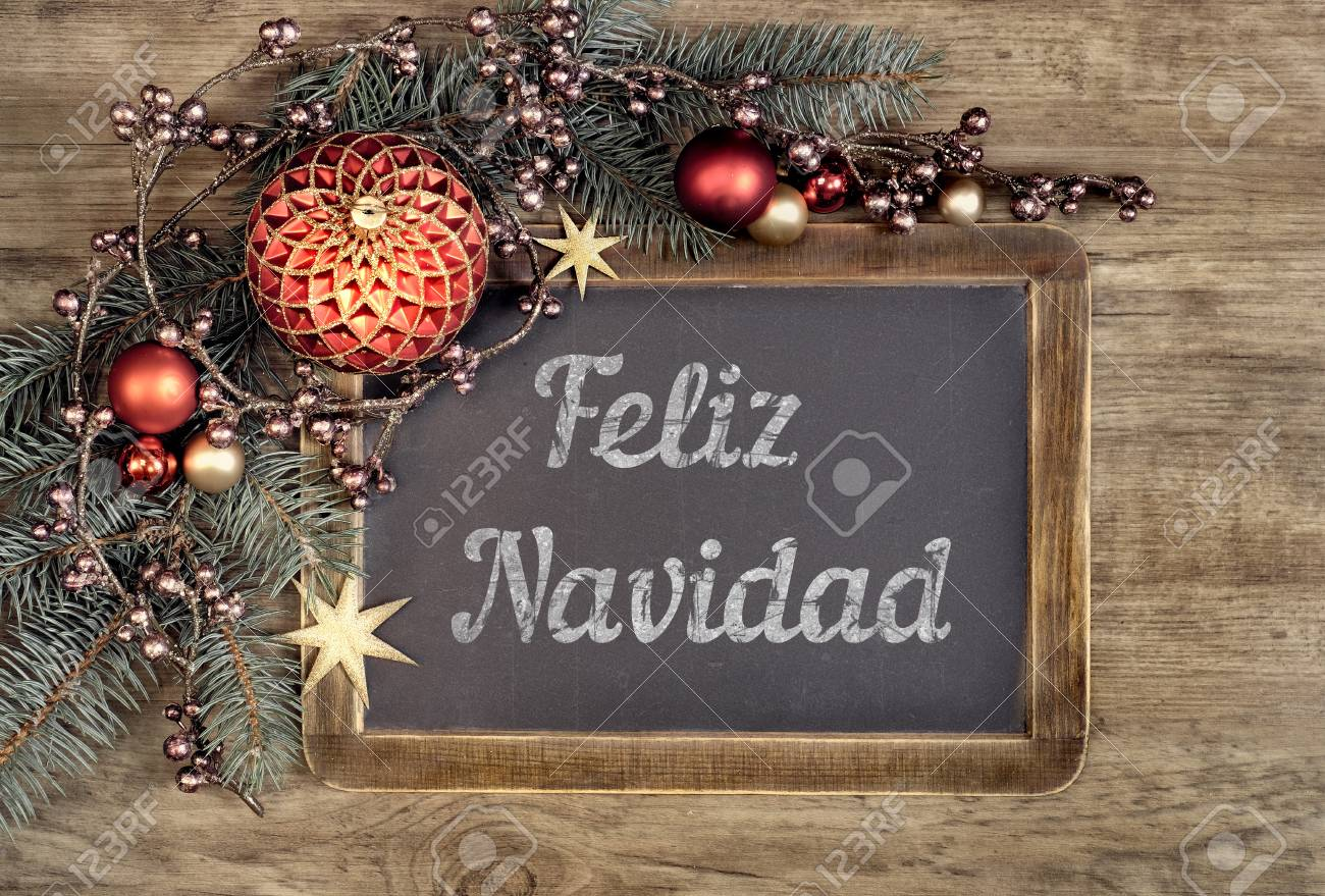 Merry Christmas In Spanish.Decorated Blackboard With Text