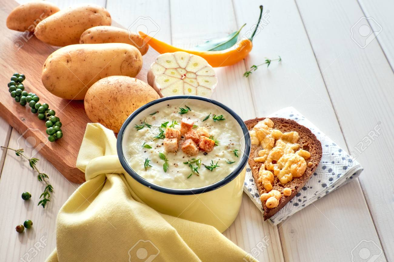 Homemade Cream Of Potato Soup With Croutons, Served With Bread Toasted With  Cheese On Light