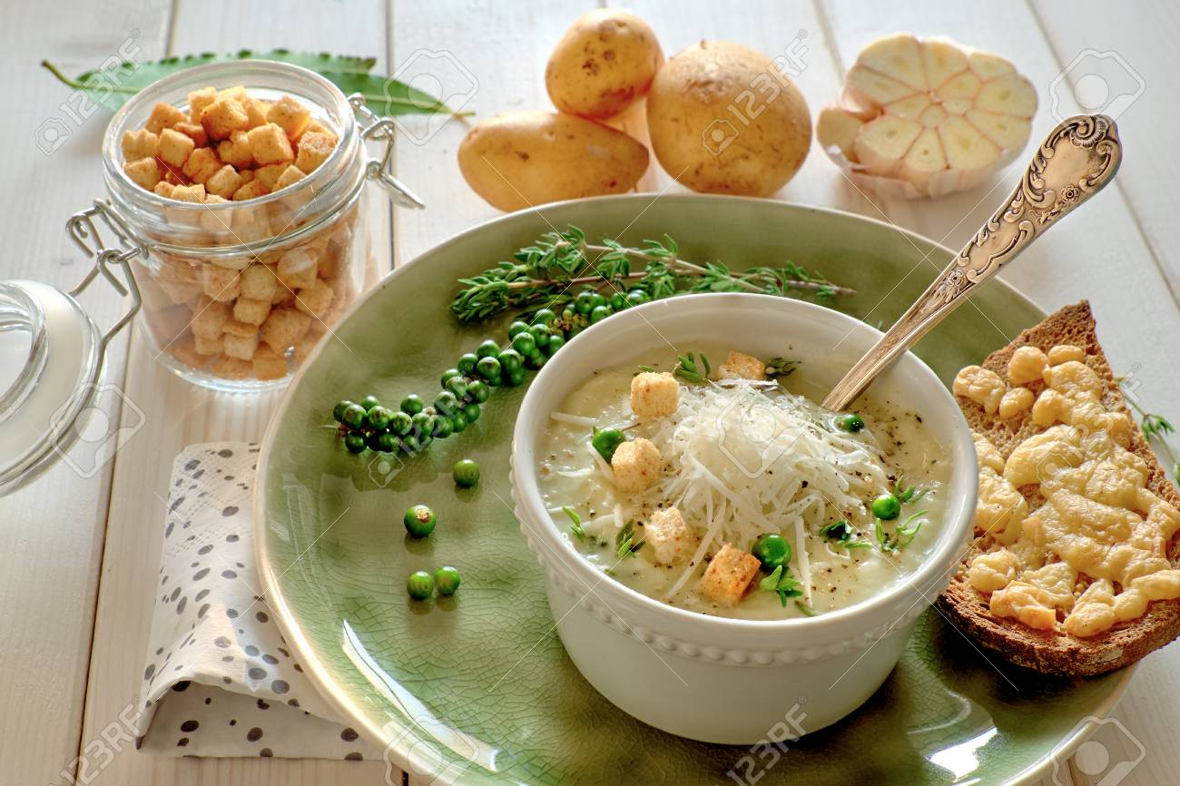 Homemade Cream Of Potato Soup With Croutons And Parmesan Cheese, Served  With Bread Toasted With