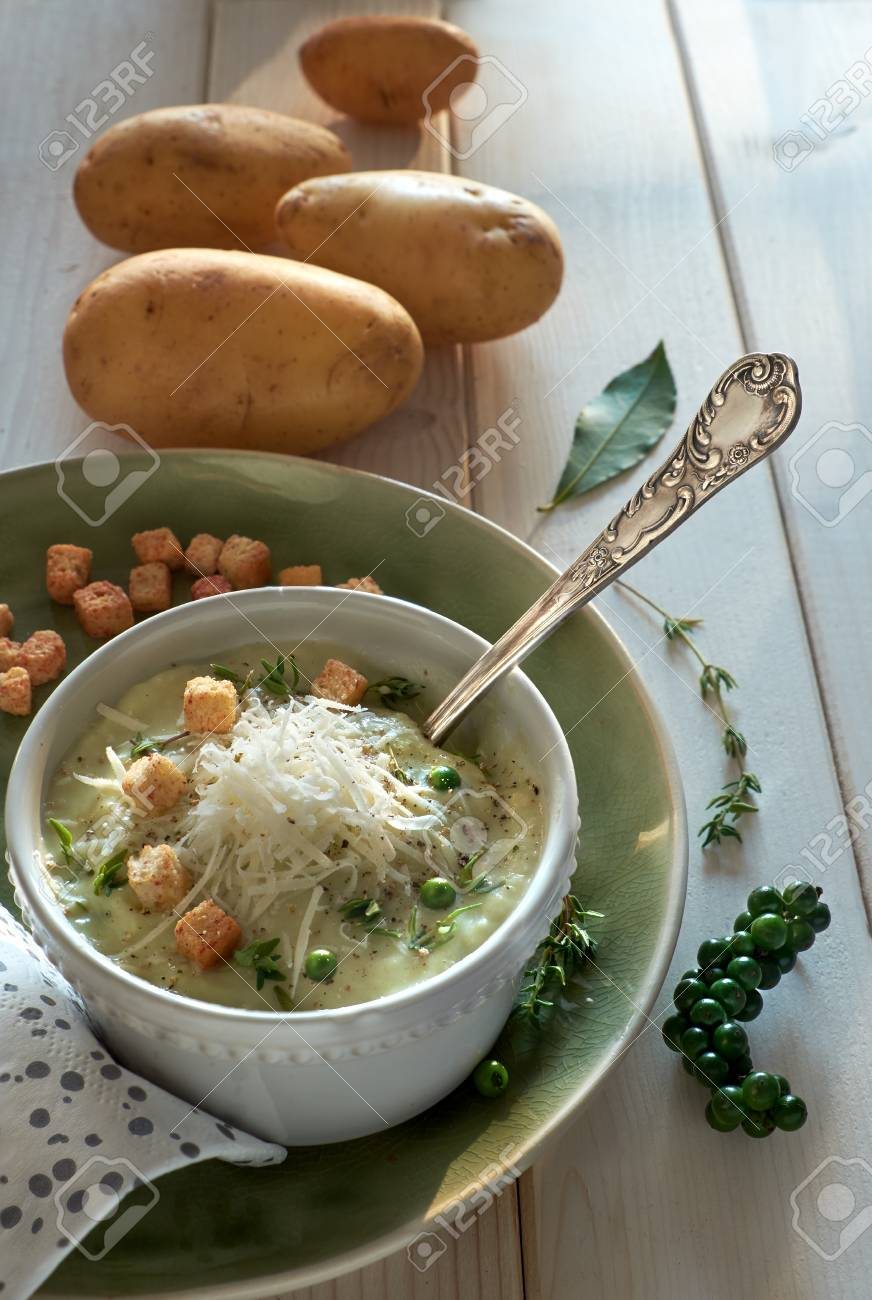 Homemade Cream Of Potato Soup In Mug With Croutons, Parmesan Cheese And  Thyme. The