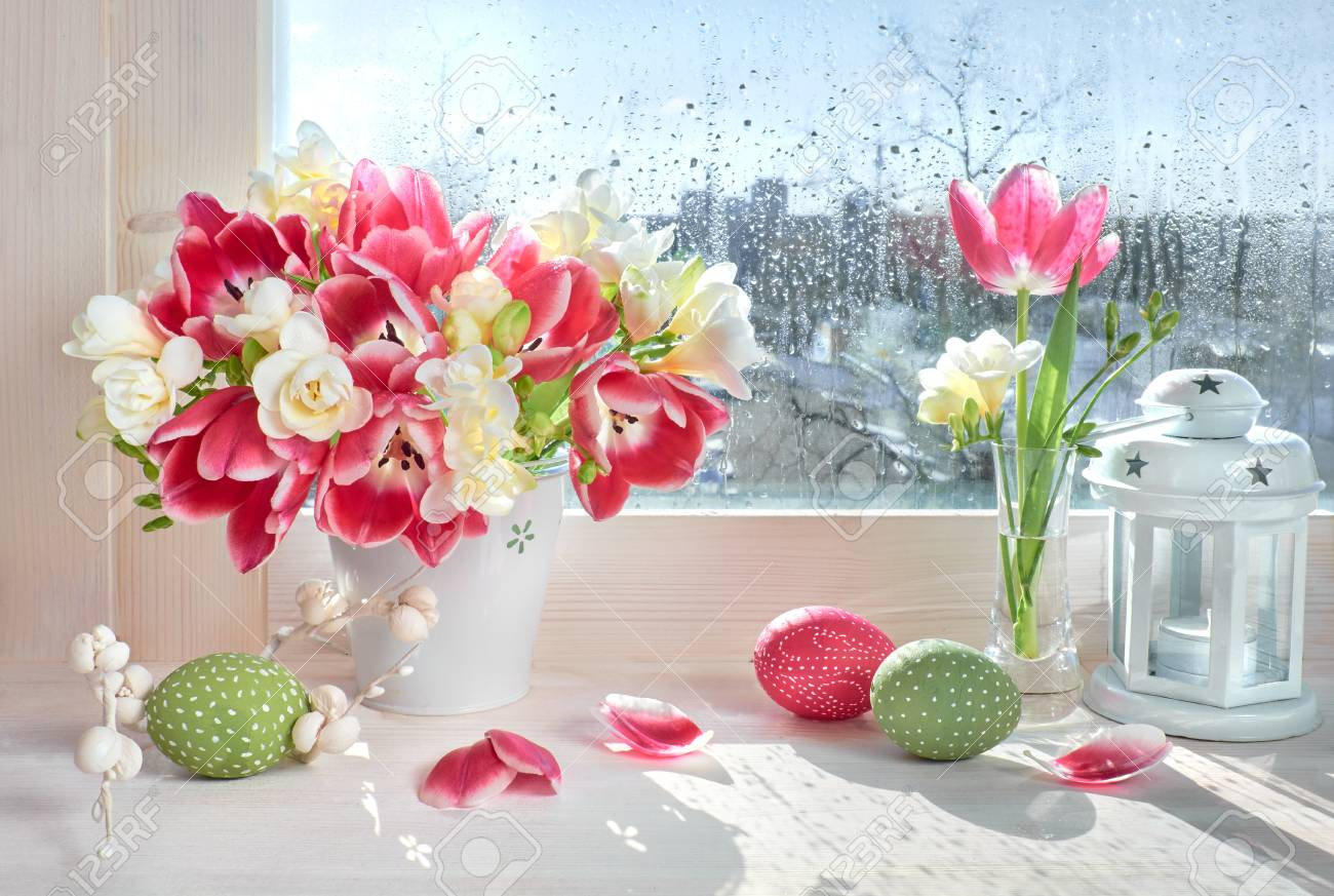 Pink Tulips And White Freesia Flowers With Easter Decorations