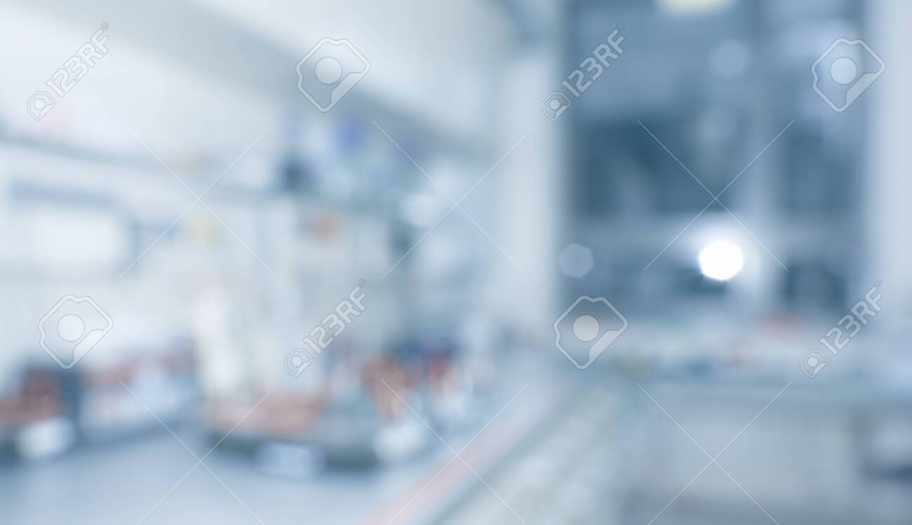 Blurred laboratory interior, scientific background, panoramic image with copy-space. Modern research facility room out of focus. This blurred image toned in grey and blue - 131099799