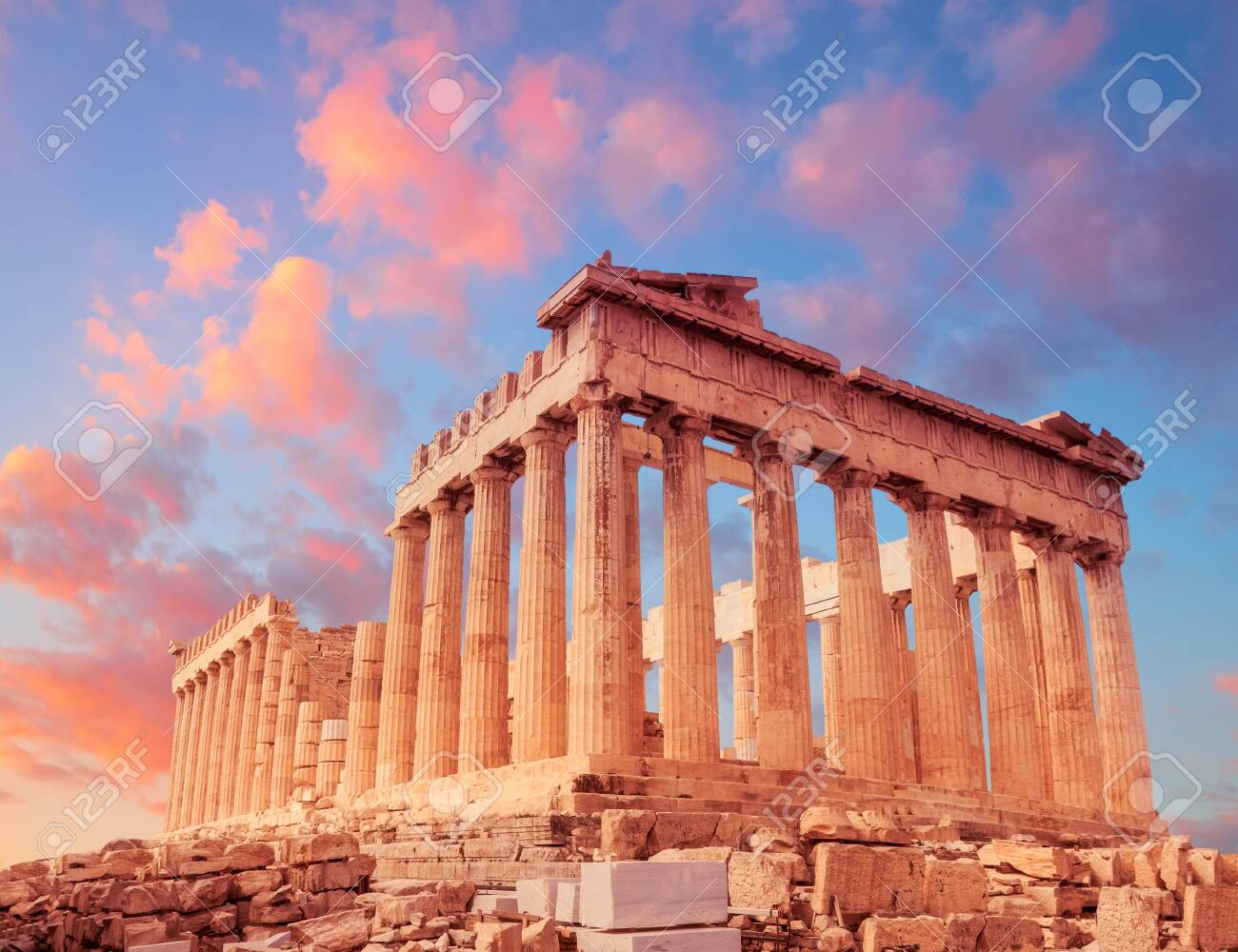 Parthenon temple on a sunset with pink and purple clouds. Acropolis in Athens, Greece - 131099812