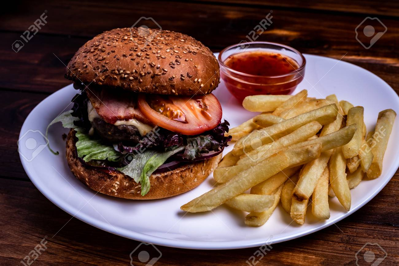 Fresh homemade burger with meat patties served with ketchup sauce