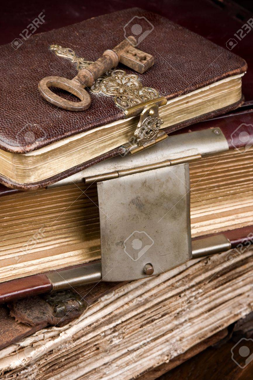 Old key lying on antique books with locks Stock Photo - 3707476