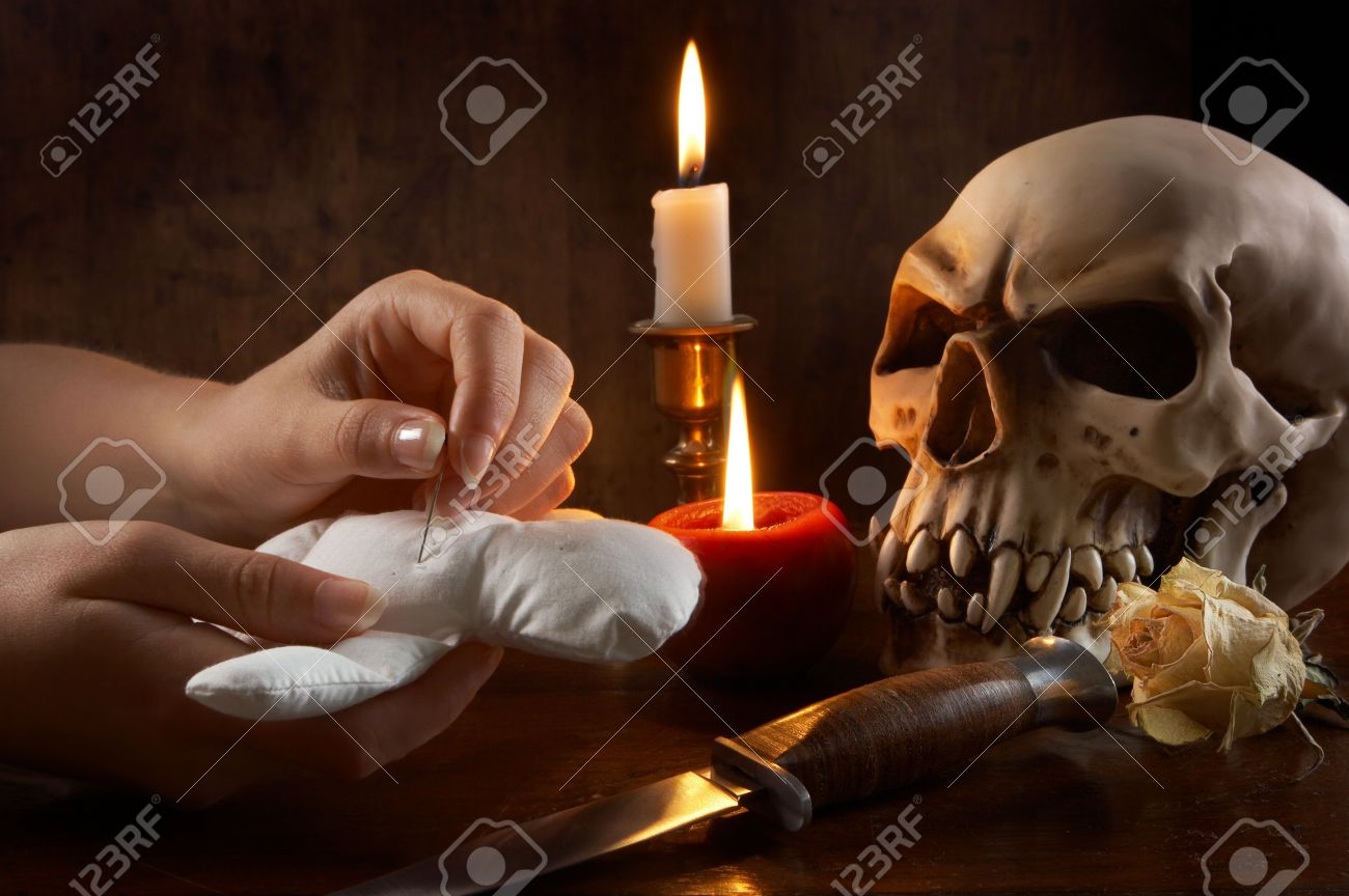 Hand sticking pins or needles in a voodoo doll Stock Photo - 3763881