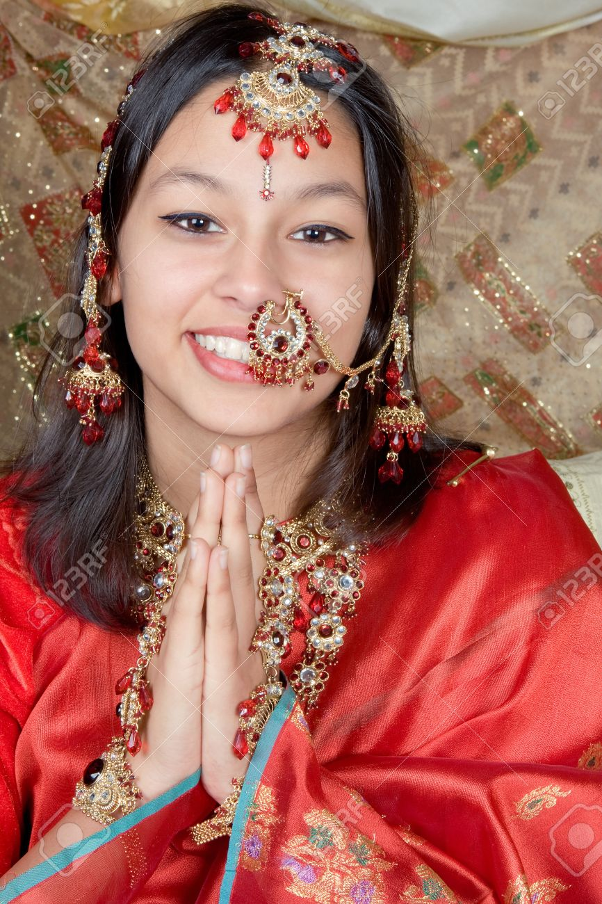 Young Indian beauty giving the Namaste greeting from India Stock Photo - 3995013