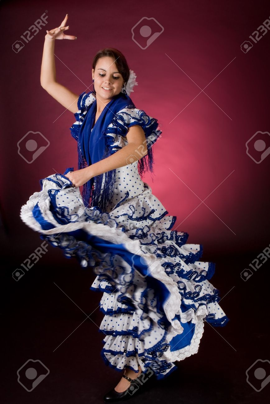 Young Spanish Flamenco Dancer In A Blue Dress, In Full Motion ...