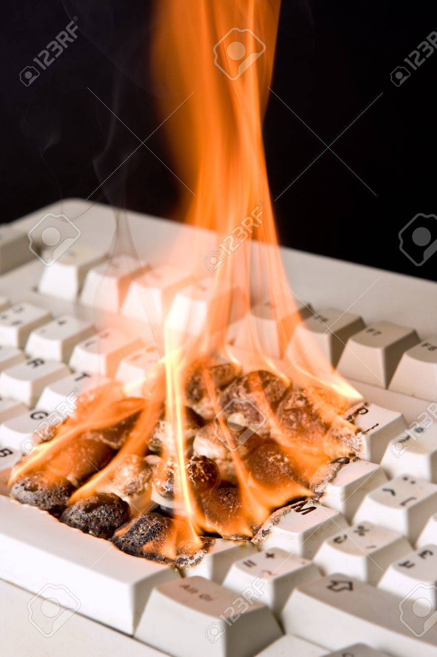 Closeup of an old computer keyboard on fire Stock Photo - 4287426