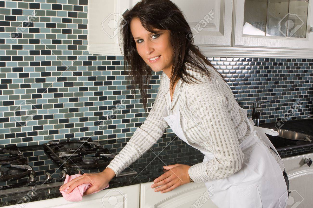 White apron ladies - Stock Photo Young Woman Cleaning The Kitchen With A Cloth