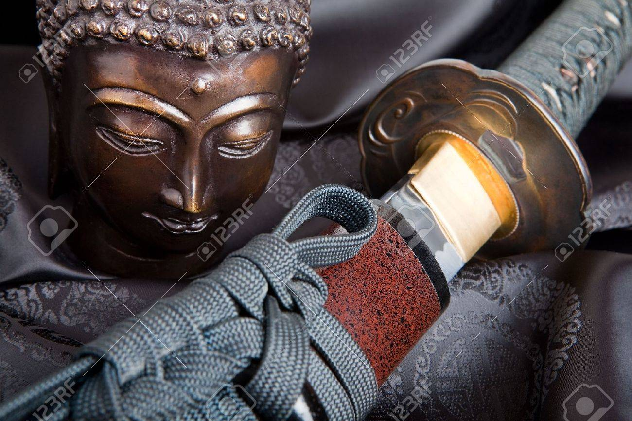 War and peace symbolized by a buddha and a japanese samurai sword Stock Photo - 5155222