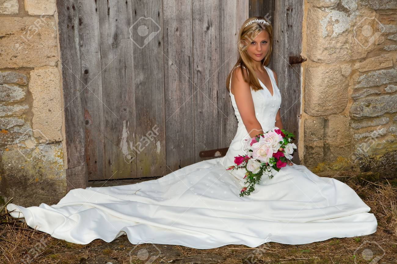 Young blonde bride against an old grunge wall Stock Photo - 5265787