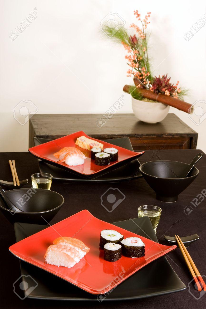 Japanese Dinner Setting With Sushi And Ikebana Flower Arrangement ...
