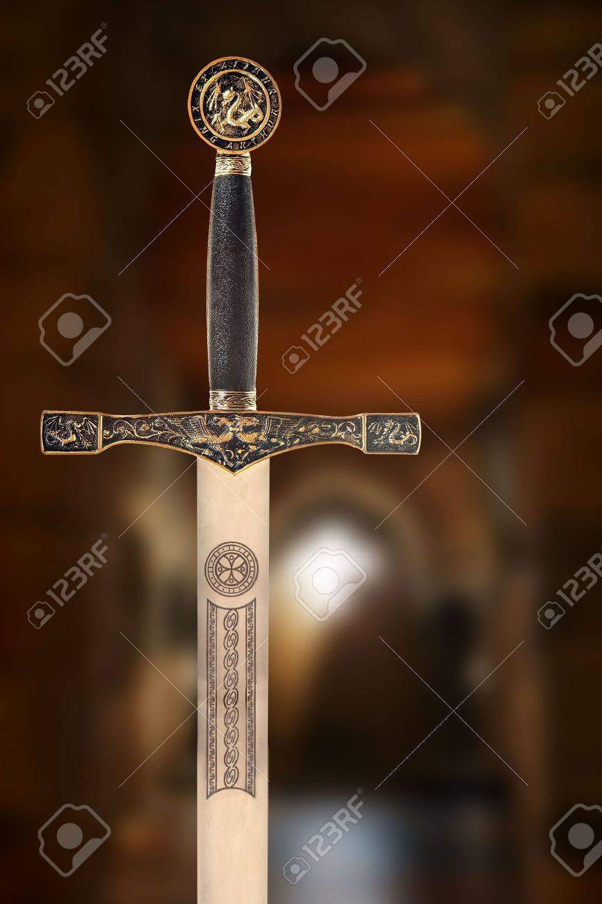 Medieval sword against a blurred background of an ancient chapel Stock Photo - 5329322