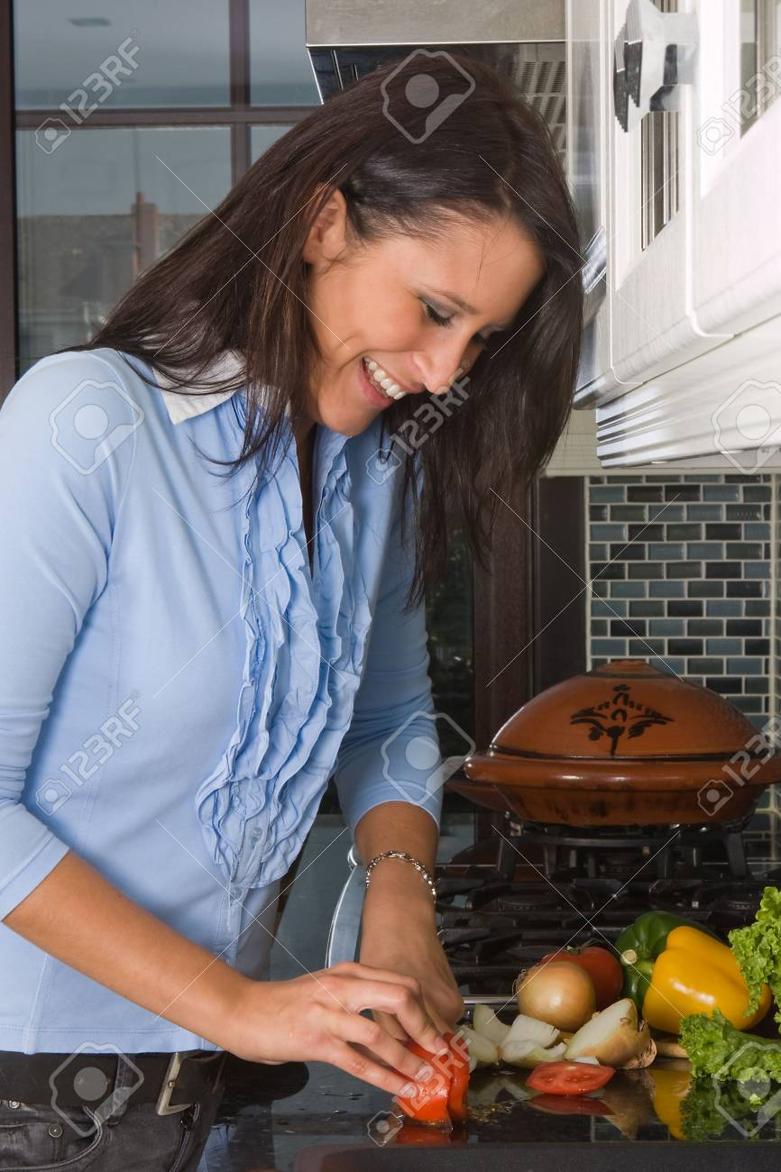 Young woman cutting vegetables in the kitchen Stock Photo - 5306735